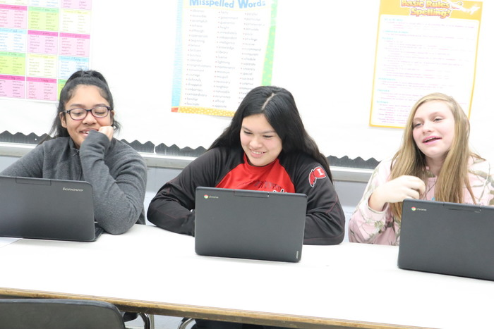 Victoria Jefferson, Grace Gibson & Nellyia Gable enjoy working on their Chromebooks