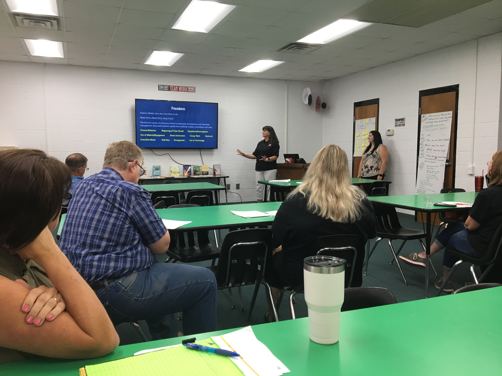Laura Bullock and Sarah Tomlinson discuss Procedures and Rules for secondary teachers during professional development sessions at IMS.