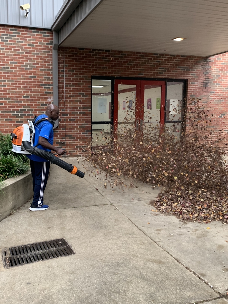 Mr. Gulley cleaning the IMS courtyard.