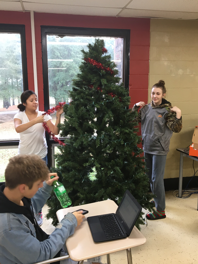 Warrior Academy students take time to decorate a Valentine tree.